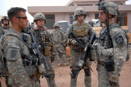 US Soldiers wearing ACUs some with the UCP-D camouflage variant.