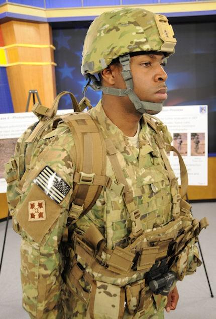 Spc. Eddie L. Williams, a computer detection repairer at Fort Belvoir, Va., models the new MultiCam Fire Resistant Army Combat Uniform