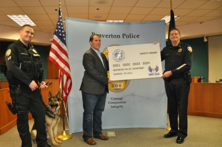 Spirit of Blue presented a $2,500 grant to the Beaverton Police Department for the acquisition of a new K9 working dog, sponsored by the Planet Dog Foundation.  The grant was presented by Ryan T. Smith of Spirit of Blue (center) and was received by (left to right) Officer Matt Barrington, K9 Atlas and Chief Geoff Spalding.