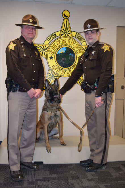 Sheriff Tony D. Frawley (left) and Deputy William D. Cline (right) surround K9 Nelson who has quickly made a name for himself as a valuable asset for the Tipton County Sheriff's Office.