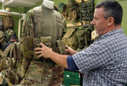 Rich Landry of the U.S. Army Soldier Systems Center laboratories in Natick, Massachusetts, demonstrates key design features included in the Airborne Tactical Assault Panel (ABN-TAP) based on Soldier input. (Photo Credit: Photo courtesy of Natick Research laboratories)