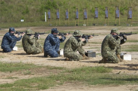 GULFPORT, Miss. (Aug. 13, 2013) Students fire M-4 carbines during a live-fire training exercise at the Center for Security Forces Learning Site. The course is designed to provide personnel with basic expeditionary combat skills training necessary to professionally and safely perform high-risk security operations when assigned to Navy Expeditionary Combat Commands. (U.S. Navy photo by Mass Communication Specialist 3rd Class Paul Coover/Released)